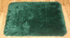 NEW PLAIN FLUFFY WASHABLE SOFT FAKE FAUX FUR DARK GREEN COLOUR SHEEP SKIN RUGS | eBay