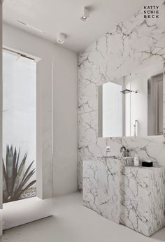Bathroom in marble in Eixample, Barcelona Spain designed by Katty Schiebeck