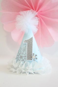 by PrettyPoshShoppe on Etsy Winter ONEderland Frozen Ice Princess Snowflake Party Hat Cake Topper Tassel Garland Banner Blue White Silver First Birthday Cake Smash