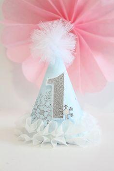 by PrettyPoshShoppe on Etsy Winter ONEderland Frozen Ice Princess Snowflake Party Hat Cake Topper Tassel Garland Banner Blue White Silver First Birthday Cake Smash