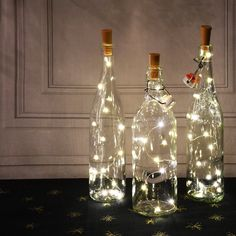 Wine Bottle Centerpieces, Lighted Centerpieces, Wedding Wine Bottles, Wine Bottle Decorations, Wedding Ideas With Wine Corks, Wine Cork Centerpiece, Centerpiece Ideas, Christmas Wine Bottles, Lighted Wine Bottles
