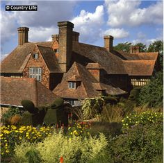 The south front of Great Dixter. The century house was combined with a century house moved from Kent and then added to by Sir Edwin Lutyens in English Manor, English House, Arts And Crafts House, Home Crafts, Edwin Lutyens, English Garden Design, Castle House, Life Pictures, Arts And Crafts Movement