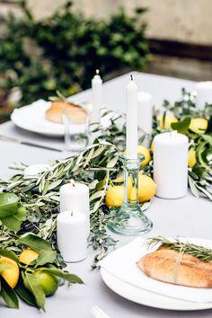 Lemon, limes and fresh herbs table runner