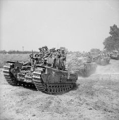 Churchill tanks carrying Royal Scots Fusiliers during the advance on St Pierre-Tarentaine, 3 August 1944.