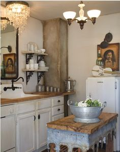 Farm house decor with an old table as an island, similar to what Tara would design in the novel Shabby Chic at Heart. Vintage fridge, open shelves, farm sink.www.authorkirstenfullmer.com