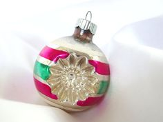 This vintage hot pink and green double indent Shiny Brite Christmas ornament is just delightful! The silver base is accented with white painted