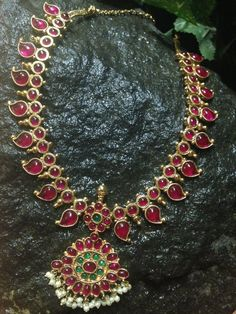 Jewellery Online Business Plan A Woman's Best Friend. Various forms of jewellery, All you have to do is just check out our exclusive collection Ruby Necklace Designs, Gold Ruby Necklace, Gold Jhumka Earrings, Antique Earrings, Mango Necklace, Antique Jewellery, Stone Necklace, Gold Jewellery Design, Gold Jewelry