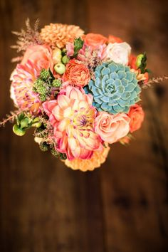Love the mix of texture & color • Peach & Mint Bridal Bouquet with~ blue green succulents, peach dahlias, peach roses, green raspberries & astilbe • Photography Credit~ Robin O'Neill Photography
