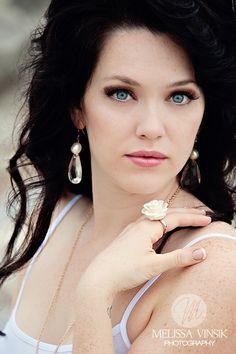 She is stunning. My favourite look, fair skin dark hair blue eyes