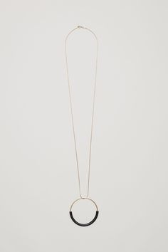 COS image 1 of Necklace with leather circle pendant  in Gold