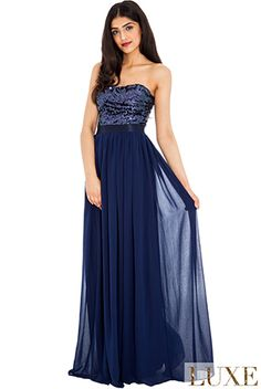 BG4620 in store now. Beautiful sequined strapless top and flowy skirt in navy chiffon.See more evening gowns on http://bridalandball.co.nz/ball-gowns/