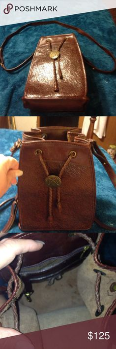 VINTAGE BRAHMIN DRAWSTRING CROSSBODY BAG 100% leather, gently used, clean bag. Has 1 inside zippered pocket, handle drop is 24 inches, purse is 10 inches deep by 8 inches wide. Purse expands to hold a lot of things. Brahmin Bags Crossbody Bags