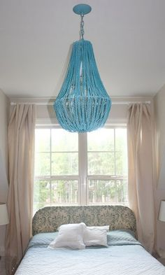 Chandelier made of mardi gra beads????  OMG!  I am so doing this!