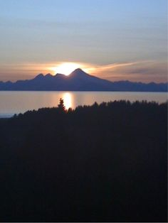 sunset over Iliamna Volcano and Cook Inlet, AK.