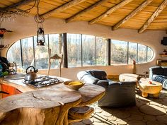 Hobbit House Poland, Krzywcza. Love the natural window design, and wood log ceiling.
