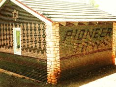 glass house made of a gillion green bottles (sprite or 7up?) in Wimberly Tx