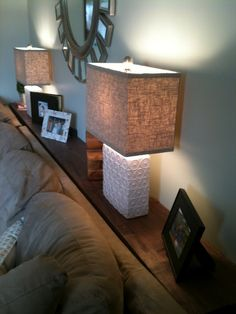 Make a ledge behind the couch with L brackets instead of using side tables.