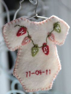 Cute idea for baby's first Christmas. SD - or to make/order now for then. I buy Christmas ornaments ever year for my grandsons. When they are decorating their first Christmas tree, they will have a good collection with, hopefully, good memories. Felt Christmas Ornaments, Noel Christmas, Handmade Christmas, Christmas Decorations, Baby First Christmas Ornament, Baby Christmas Ornaments, Button Ornaments, Homemade Decorations, Ornaments Ideas