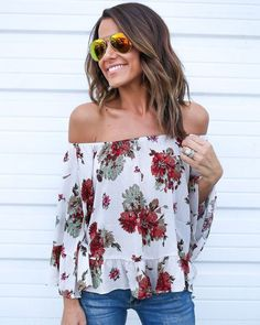 I generally am not a fan of ruffles, but I love the flow/off the shoulder bit, and the print