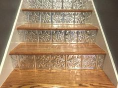 Faux pushed tin ceiling tiles cut to fit stair risers! Faux pushed tin ceiling tiles cut to fit stair risers! Styrofoam Ceiling Tiles, Faux Tin Ceiling Tiles, Tin Tiles, Tin Ceiling Kitchen, Ceiling Tiles Painted, Tiles Uk, Casa Magnolia, Stair Makeover, Basement Stairs
