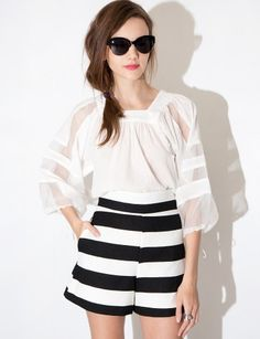 The perfect high waisted shorts featuring black and white stripes and high waist fit. Fully lined with hidden back zipper. Style these dressy cocktail shorts with a pretty lace blouse. *100% polyester*Waist 25