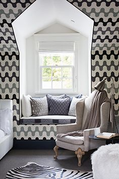 """Design Detail: A thin black border around the bay windows elegantly marks a distinct """"nook"""" area that's separate from the rest of the room. Amazing what a coat of white paint and a sleek window treatment (blinds) will do to create a pared down vibe."""