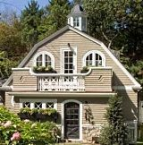 A Gambrel roof line...hmmm nice color scheme and texture to make it cottage-y.