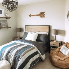 We're all about this modern rustic vibe featuring our Kearny furniture, Goodsport Quilt and Modern Lounger 🙌 (📷: Leather Bean Bag Chair, Sports Quilts, Twin Xl Mattress, Make Your Bed, Pottery Barn Teen, Lounge Seating, Dream Bedroom, Upholstery, Interior Design