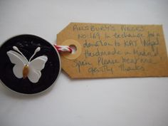 Pillsbury?s Pieces No, 169. Pin - black capsule with white paper butterfly. In exchange for a donation to KATHMANDU ANIMAL TREATMENT CENTRE, Nepal. Available at St. George's Church, Madrid on Saturday 13 June from 11.00 - 15.00.