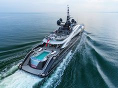 The OKTO superyacht features a pool, guest elevator, owner's balcony, and 4 garages. Price: $66 million.