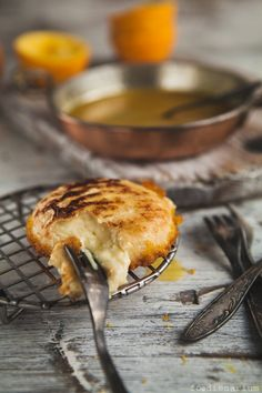 PAN-FRIED CAMEMBERT WITH ORANGE SAUCE  To make the cheese itself:  2 packages camembert  1 cup bread crumbs    To make a sauce:  1 cup orange juice fresh  1 tbsp orange zest  3 tbsp brown sugar  3 tbsp butter  pinch salt