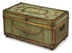 A DECORATED LEATHER AND BRASS MOUNTED TRUNK   LATE 19TH CENTURY   With paper-lined camphor interior, side carrying handles and mounted on castors, re-decorated  18 in. (46 cm.) high; 34½ in. (88 cm.) wide; 18 in (46 cm.) deep  1975gbp