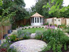 Octagonal painted summerhouse takes pride of place in this garden. Summer House Interiors, Summer House Garden, Summer Houses, Grand Luxe, Cedar Garden, Zen, Outdoor Gazebos, Garden Villa, Garden Design Plans