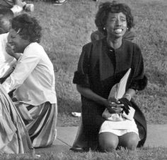 """Danella Bryant praying during a demonstration outside the traffic engineering building, Birmingham, 5 May 1963. """"I was really, really involved. And the reason I could be involved, unlike some of my peers, was that my father owned his own business. He wasn't easily intimidated... I didn't realize at the time how dangerous the situation was. The only thing I was concerned with was that I wanted my freedom, I wanted to be able to go where I wanted, like everybody else did...""""  Photo by Gary…"""
