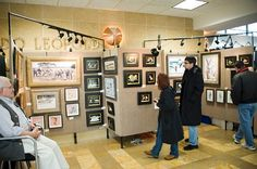 art exebition visitors    art show 2013 artwork and visitors with artist looking on