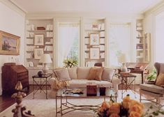 monochromatic living room, windows are not even but bookcases hide