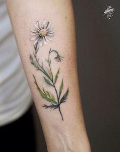 Magdalena Bujak daisy flower tattoo