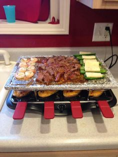 Meats, veggies, fish and potatoes all in one place! I love the Velata Raclette!!