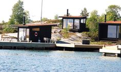 "For those wishing for an escape from the wired world, feast your eyes on this cluster of off-grid seaside cabins. Stockholm-based Margen Wigow Arkitektkontor designed five blackened timber holiday structures on the shores of a remote island in the Stockholm archipelago. Commissioned by a client who wanted to ""live a simple life close to nature,"" these green-roofed huts serve as a cozy retreat that references the traditional island vernacular and boasts stunning views of the Baltic Sea."