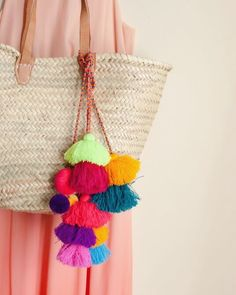 See our collection of pom poms and Moroccan straw bags on the site merakihomeaccents.com