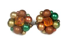 Offered to you from The Fashion Den is this lovely pair of plastic cluster bead earrings in the colors of brown, green, gold, orange, all set in brassy gold tone metal.  Th... #vintage #jewelry #etsygift #sale #thefashionden