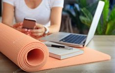 Woman and an exercise mat in an office background photo by rawf8 on Envato Elements