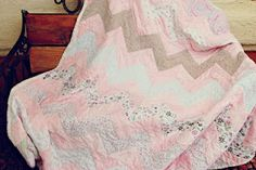 Repurposed quilt from Babblings and More.  What a great idea!  She made a larger quilt using her daughter's receiving blankets.