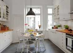 Simple and cozy kitchen design: tiles, cupboards, lamp
