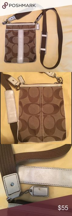 Coach brown/white cross body bag Brown/white cross body bag from Coach. Some wearing on the white leather as seen in picture 3. Great casual bag! Coach Bags Crossbody Bags