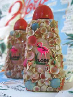 Vintage 1950s Florida souvenir salt and pepper shakers with tiny shells and flamingos - Anchor Hocking