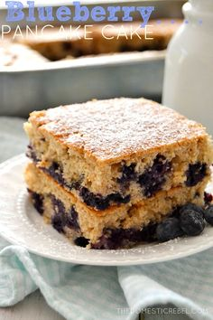 This Blueberry Pancake Cake takes the work out of making pancakes! Fluffy, sweet, maple-y and studded with fresh blueberries, this cake will soon become a family favorite!