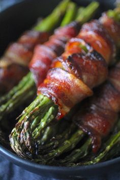 These Bacon Wrapped Asparagus Bundles with Maple Glaze are sure to make any meal feel special! The perfectly cooked asparagus is wrapped in crisp salty bacon, and each bundle is brushed with the perfect amount of maple glaze, what& not to love! Grilled Bacon Wrapped Asparagus, Asparagus In Oven, Asparagus Appetizer, Bacon Wrapped Chicken Bites, Bacon Appetizers, How To Cook Asparagus, Asparagus Recipe, Appetizer Recipes, Asparagus With Bacon