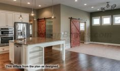 Maddox , Home Plan 29052 Kitchen with pantry and pocket office accessed by hanging doors.