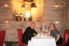 We are eating in the dungeon at Dalhousie Castle at Bonny Rigg, Scotland.